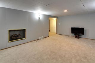 Photo 15: 22 Rossburn Crescent SW in Calgary: Rosscarrock Detached for sale : MLS®# A1083090