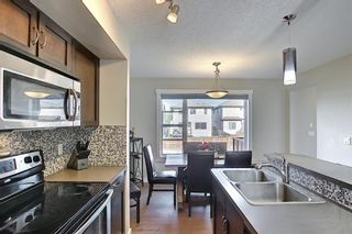 Photo 9: 144 PANAMOUNT Way NW in Calgary: Panorama Hills Semi Detached for sale : MLS®# A1114610