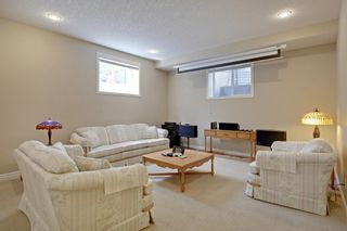 Photo 31: 145 TREMBLANT Place SW in Calgary: Springbank Hill Detached for sale : MLS®# A1024099