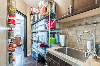 Photo 12: 157 Springbluff Boulevard SW in Calgary: Springbank Hill Detached for sale : MLS®# A1129724
