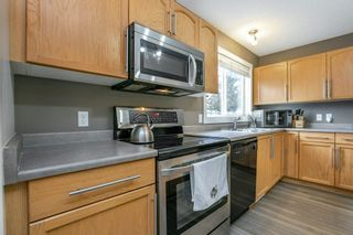 Photo 18: 5061 STANTON Drive in Edmonton: Zone 53 House Half Duplex for sale : MLS®# E4250315