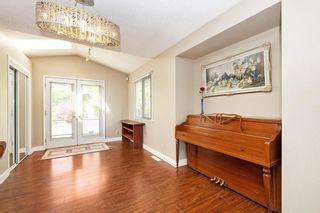 Photo 5: 709 QUADLING Avenue in Coquitlam: Coquitlam West House for sale : MLS®# R2577078