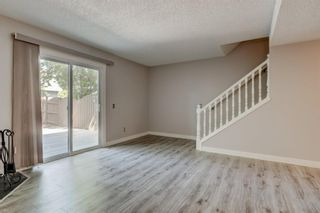 Photo 9: 34 6503 RANCHVIEW Drive NW in Calgary: Ranchlands Row/Townhouse for sale : MLS®# A1018661