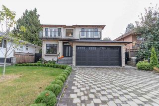 Photo 1: 7760 ROSEWOOD Street in Burnaby: Burnaby Lake House for sale (Burnaby South)  : MLS®# R2542340