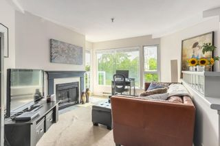 "Photo 2: 302 2010 W 8TH Avenue in Vancouver: Kitsilano Condo for sale in ""AUGUSTINE GARDENS"" (Vancouver West)  : MLS®# R2197436"