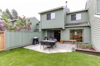 """Photo 1: 3 9994 149 Street in Surrey: Guildford Townhouse for sale in """"TALL TIMBERS"""" (North Surrey)  : MLS®# R2369624"""