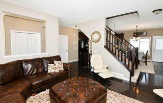 Photo 5: 304 CIMARRON VISTA Way: Okotoks House for sale : MLS®# C4172513
