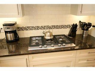 Photo 18: 156 GLENEAGLES Close: Cochrane House for sale : MLS®# C4018066