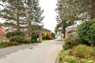 """Photo 1: 150 15550 26 Avenue in Surrey: King George Corridor Townhouse for sale in """"SUNNYSIDE GATE"""" (South Surrey White Rock)  : MLS®# R2571314"""