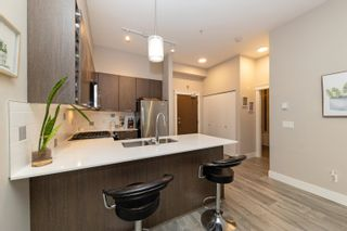 Photo 4: 106 1188 JOHNSON Street in Coquitlam: Eagle Ridge CQ Condo for sale : MLS®# R2612191