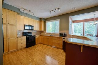 Photo 17: 323 Discovery Place SW in Calgary: Discovery Ridge Detached for sale : MLS®# A1141184