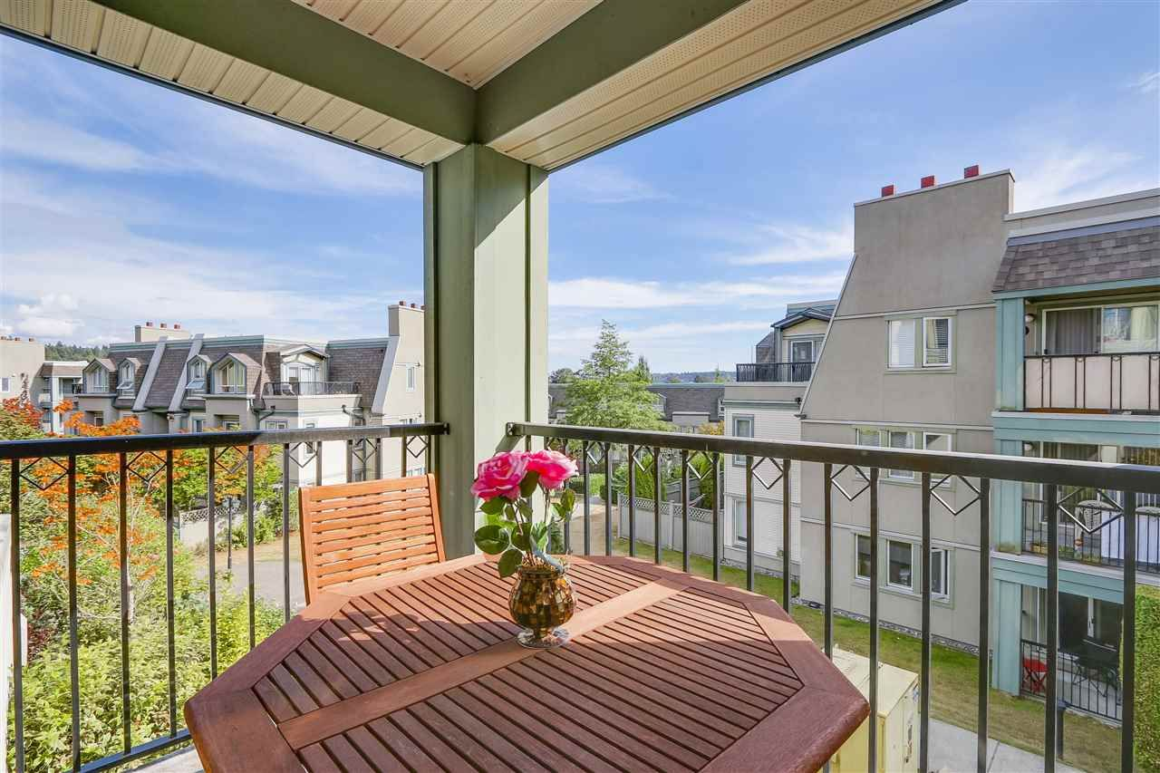 """Main Photo: 102 219 BEGIN Street in Coquitlam: Maillardville Townhouse for sale in """"PLACE FOUNTAINE BLEU"""" : MLS®# R2206798"""