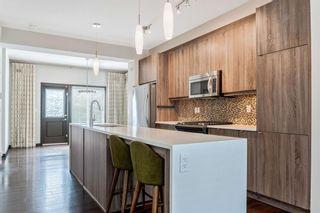 Photo 5: 1015 Evansridge Common NW in Calgary: Evanston Row/Townhouse for sale : MLS®# A1134849