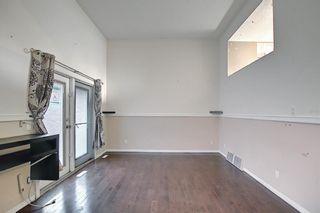 Photo 4: 1002 919 38 Street NE in Calgary: Marlborough Row/Townhouse for sale : MLS®# A1140399