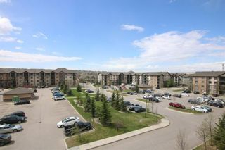 Photo 2: 1304 60 Panatella Street NW in Calgary: Panorama Hills Apartment for sale : MLS®# A1131653