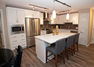 Photo 2: 2106 10 Market Boulevard SE: Airdrie Apartment for sale : MLS®# A1054514