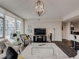 Photo 8: 201 560 6 Avenue SE in Calgary: Downtown East Village Apartment for sale : MLS®# A1063325