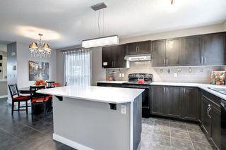 Photo 15: 1319 Panatella Boulevard NW in Calgary: Panorama Hills Semi Detached for sale : MLS®# A1145532