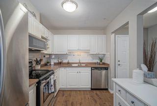 "Photo 10: 103 9650 148TH Street in Surrey: Guildford Condo for sale in ""HARTFORD WOODS"" (North Surrey)  : MLS®# R2617225"