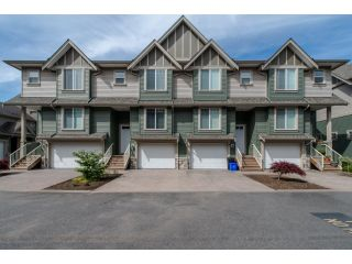 "Photo 1: 59 6498 SOUTHDOWNE Place in Sardis: Sardis East Vedder Rd Townhouse for sale in ""Village Green"" : MLS®# R2059470"