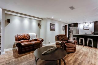Photo 23: 93 SOMME Boulevard SW in Calgary: Garrison Woods Row/Townhouse for sale : MLS®# C4241800