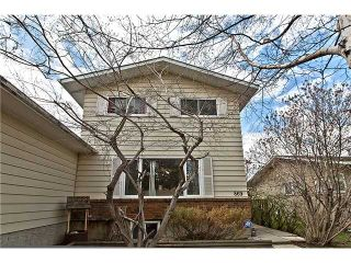 Photo 1: 869 QUEENSLAND Drive SE in CALGARY: Queensland Residential Attached for sale (Calgary)  : MLS®# C3616074
