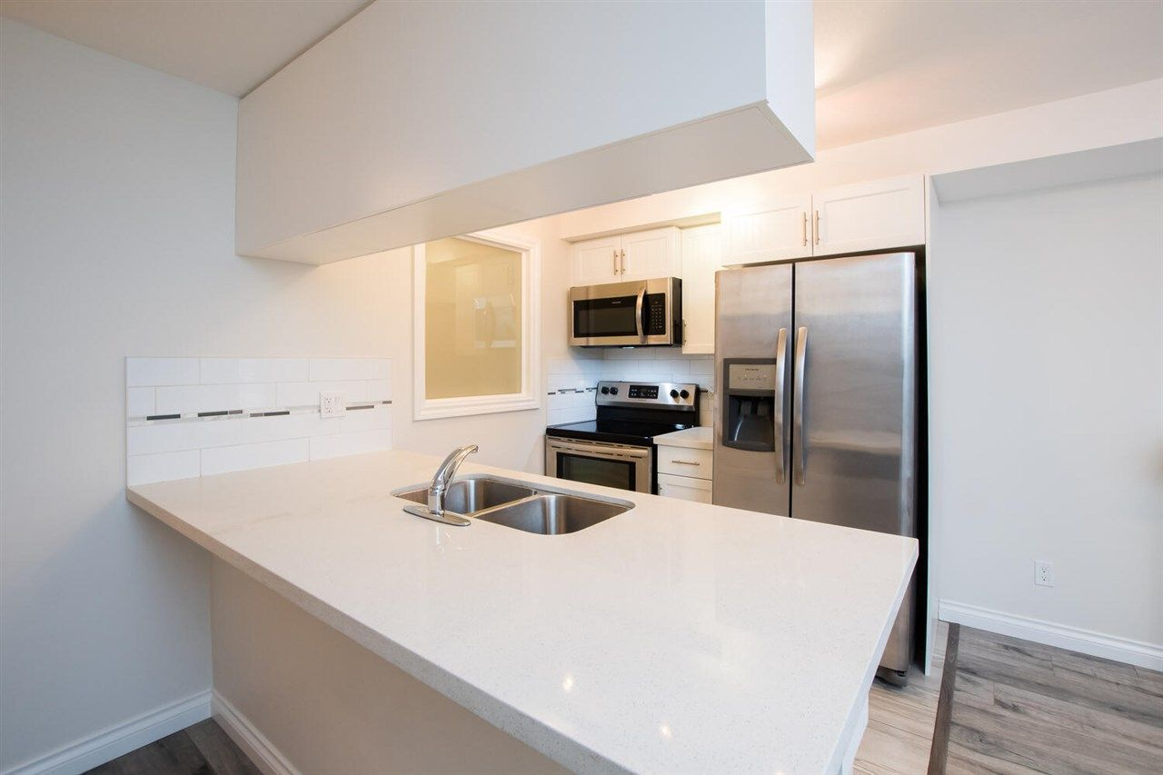 """Photo 5: Photos: 109 5650 201A Street in Langley: Langley City Condo for sale in """"PADDINGTON STATION"""" : MLS®# R2549015"""