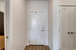 Photo 3: 104 30 Shawnee Common SW in Calgary: Shawnee Slopes Apartment for sale : MLS®# A1099308