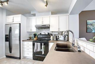 Photo 12: 3028 New Brighton Gardens SE in Calgary: New Brighton Row/Townhouse for sale : MLS®# A1125988