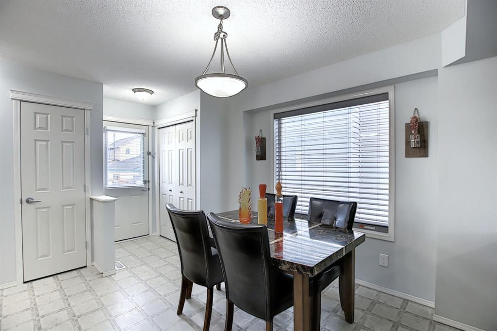 Photo 9: Photos: 646 EVERMEADOW Road SW in Calgary: Evergreen Detached for sale : MLS®# A1023171