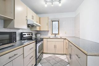 Photo 14: 318 43 Street SE in Calgary: Forest Heights Row/Townhouse for sale : MLS®# A1136243