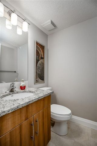 Photo 25: 2408 15 Sunset Square: Cochrane Apartment for sale : MLS®# A1123430