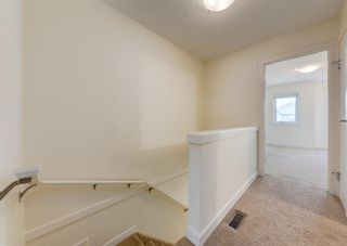 Photo 16: 402 2445 Kingsland Road SE: Airdrie Row/Townhouse for sale : MLS®# A1107683