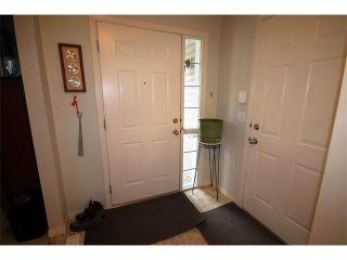 Photo 3: 2 117 BOW RIDGE Drive: Cochrane House for sale : MLS®# C4003118