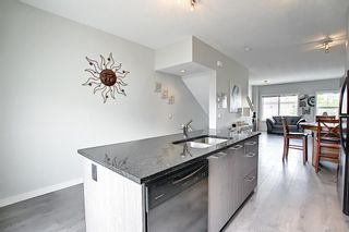 Photo 7: 2103 Jumping Pound Common: Cochrane Row/Townhouse for sale : MLS®# A1119563