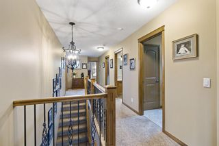 Photo 23: Spacious and Beautiful Valley Ridge Home backing out on to the Ravine