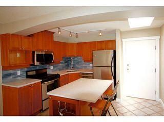 "Photo 2: 404 1432 PARKWAY Boulevard in Coquitlam: Westwood Plateau Condo for sale in ""Ironwood- Montreux"" : MLS®# V1135534"