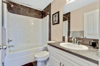 Photo 28: 744 RIVER HEIGHTS Crescent: Cochrane Semi Detached for sale : MLS®# A1026785