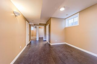 Photo 19: 415 52 Avenue SW in Calgary: Windsor Park Semi Detached for sale : MLS®# A1112515