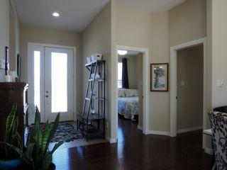 Photo 2: 695 Mclenaghen Drive in Portage la Prairie: House for sale : MLS®# 202109619