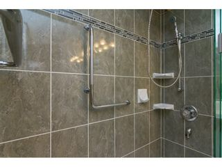 "Photo 10: 106 13860 70 Avenue in Surrey: East Newton Condo for sale in ""Chelsea Gardens"" : MLS®# R2243346"