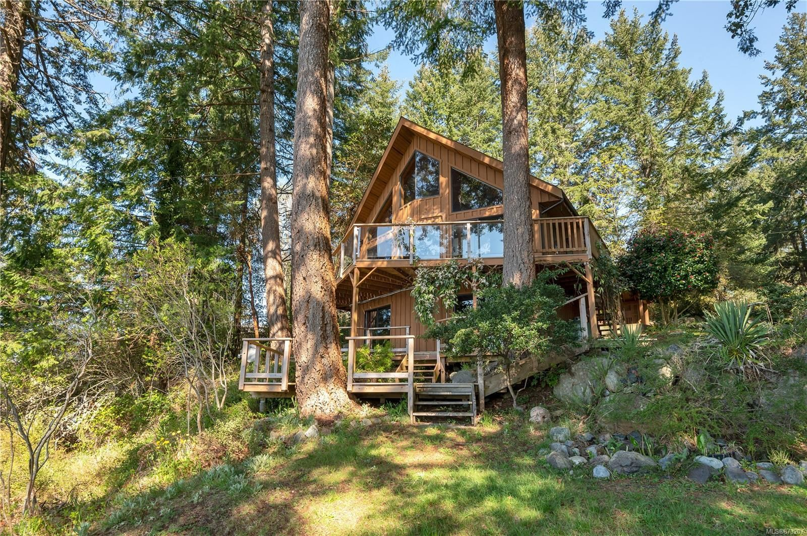 Gowlland Harbour oceanfront home on 1 acre with 170 feet of walk-on ocean frontage!