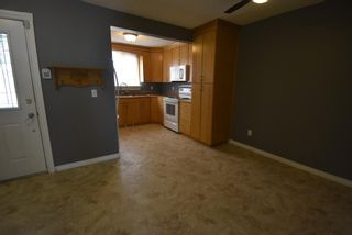 Photo 4: 7 1706 22 Avenue: Didsbury Row/Townhouse for sale : MLS®# A1112062