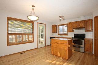 Photo 7: 22 WEST COPITHORNE Place: Cochrane House for sale : MLS®# C4121744