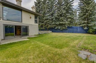 Photo 36: 512 Coach Grove Road SW in Calgary: Coach Hill Detached for sale : MLS®# A1127138
