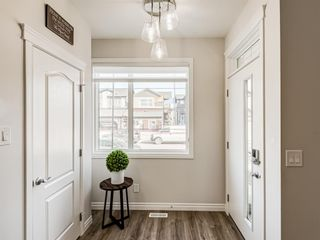 Photo 7: 35 Wolf Hollow Way in Calgary: C-281 Detached for sale : MLS®# A1083895