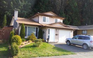 "Photo 1: 1232 BLUFF Drive in Coquitlam: River Springs House for sale in ""RIVER SPRINGS"" : MLS®# R2222588"