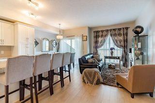 Photo 2: 639 101 SUNSET Drive: Cochrane House for sale : MLS®# C4143870