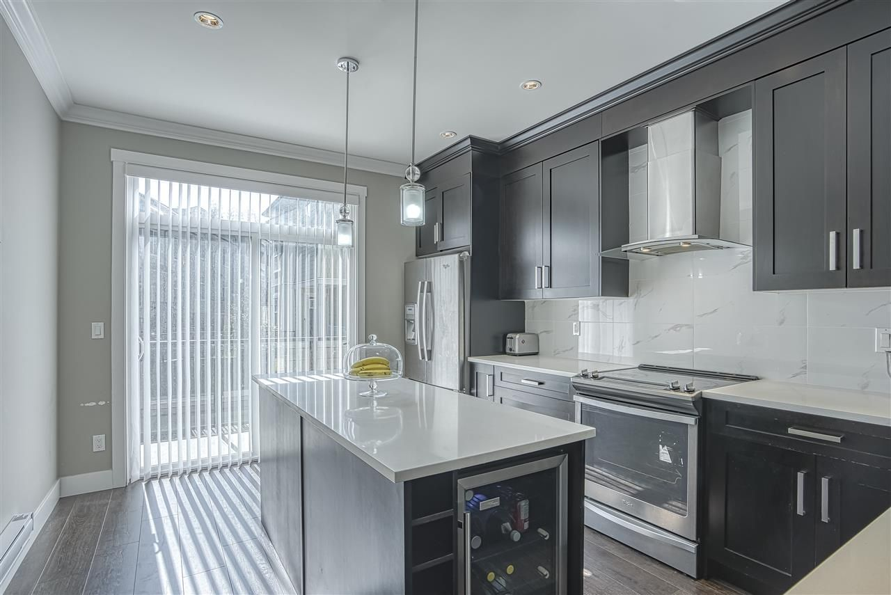"""Main Photo: 107 13670 62 Avenue in Surrey: Sullivan Station Townhouse for sale in """"Panorama South 62"""" : MLS®# R2450811"""