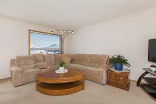 Photo 7: 86 COVENTRY View NE in Calgary: Coventry Hills House for sale